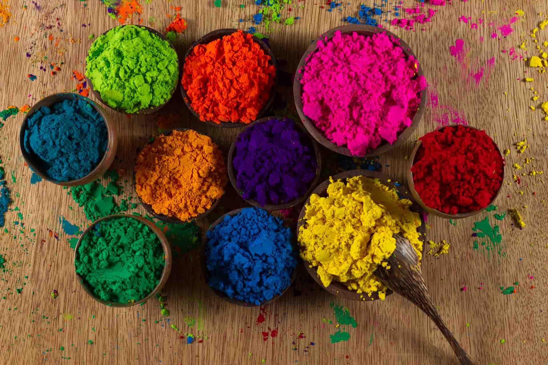 many small bowl of finely powdered Indian pigments in a variety of colours